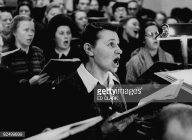 82499889-congregation-singing-christma-gettyimages
